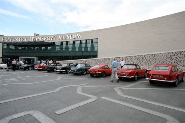 Classic cars line up outside the museum