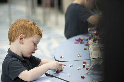 boy constructing with Lego bricks