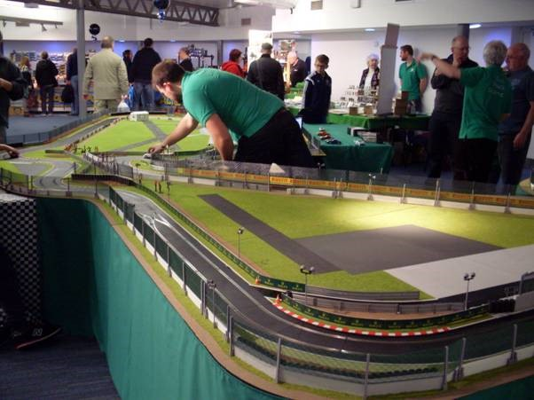 a busy slot car market with track laid out