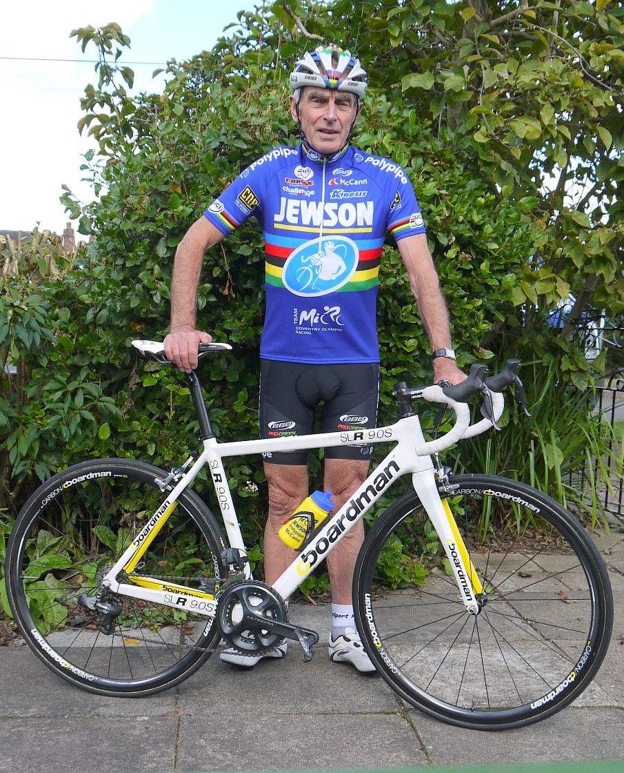Mick Ives standing next to a bike